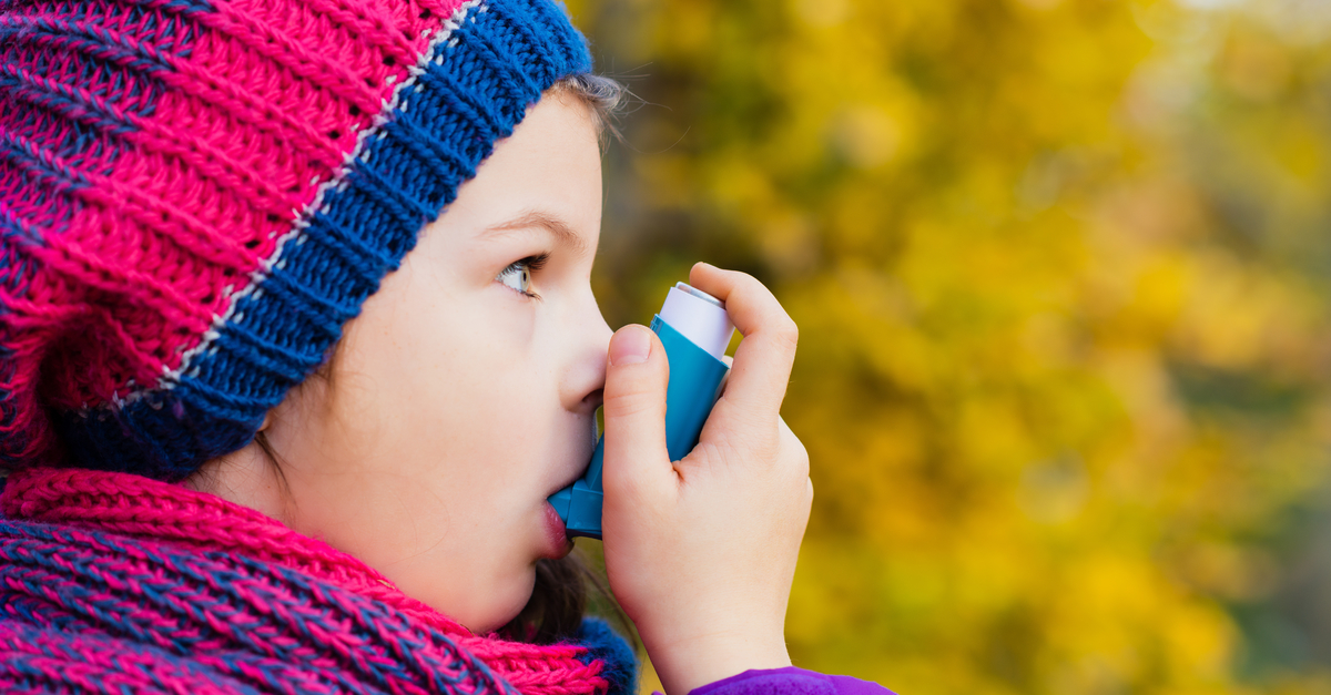 East Lansing manage your fall allergies and asthma girl with inhaler autumn background